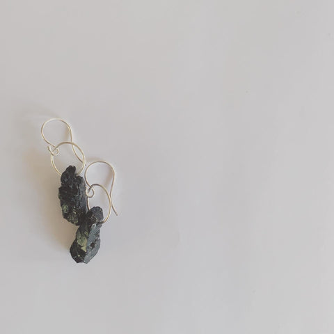 Rough cut and raw black tourmaline earrings  This stone is so deep and beautiful.... exceptionally grounding to the earth's energies.  Black Tourmaline repels and blocks negative energies. It will cleanse, purify and transform dense energy into a lighter vibration.