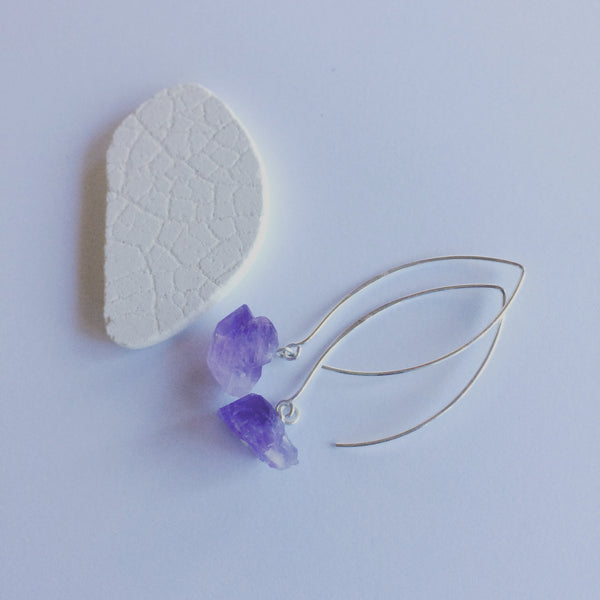 Amethyst Earrings. Rough cut, raw amethyst earrings on sterling silver wishbone ear hooks, 40mm.  The light breeze that shifts with this protective and meditative amethyst gemstone hanging lightly from the beautiful shape of wishbone ear hooks......