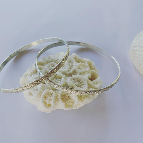 Sterling silver textured bangle. This textured beauty is funky and its silver!!  To add to those forever pieces.........  Made to last and made to love💓  Great as a trio, on it's own or mix it up with our different size solid sterling silver bangles.  It is a 4mm thick sterling silver bangle.  The inner diameter is 63mm.