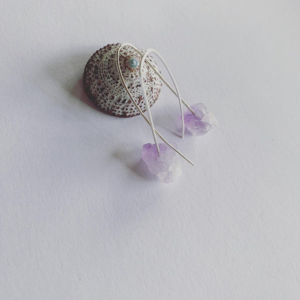 Amethyst Earrings.Rough cut, raw amethyst earrings on sterling silver wishbone ear hooks, 40mm.  The light breeze that shifts with this protective and meditative amethyst gemstone hanging lightly from the beautiful shape of hair pin ear hooks......