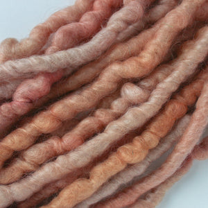 Handdyed corespun yarn in antique blush color.