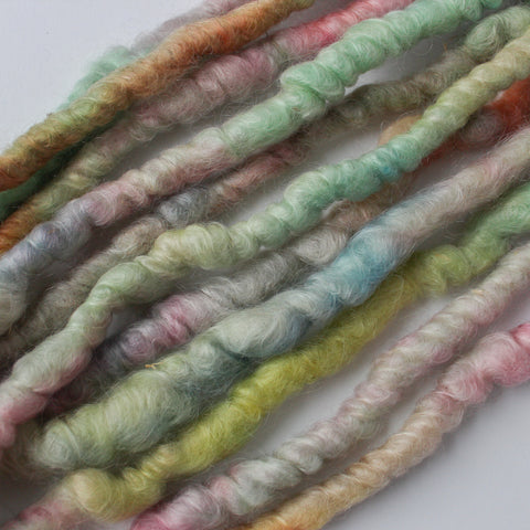 Corespun mohair yarn handdyed in a palette of bright pastels.