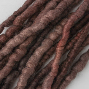 Rich plum and brown color handdyed on corespun mohair.