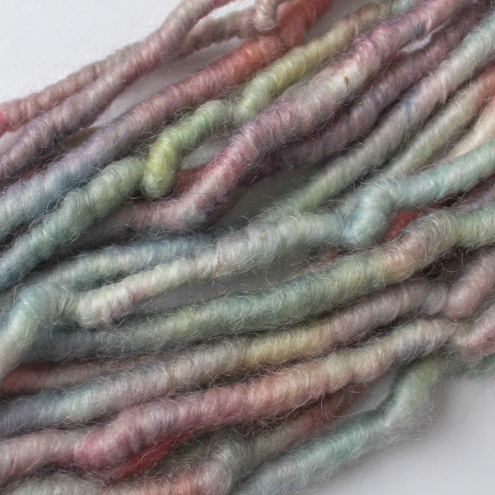 A blend of desert colors hand dyed on corespun  mohair yarn.