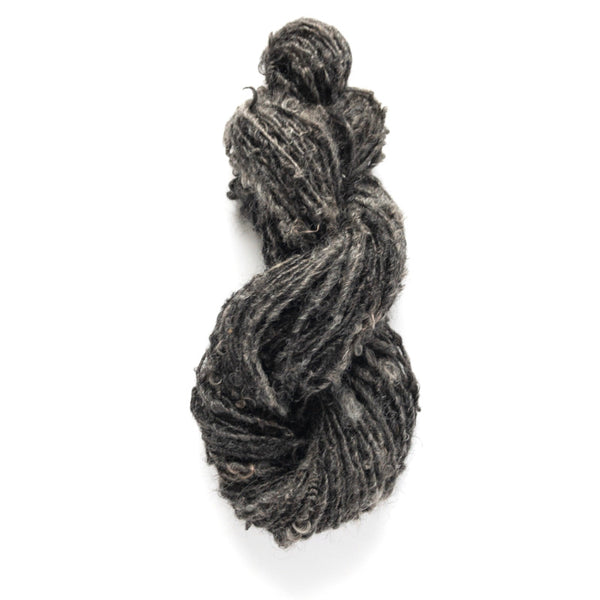 Handspun rustic skein of mohair yarn in charcoal gray