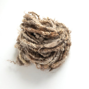 Shades of natural brown mohair handspun lockspun yarn from our farm