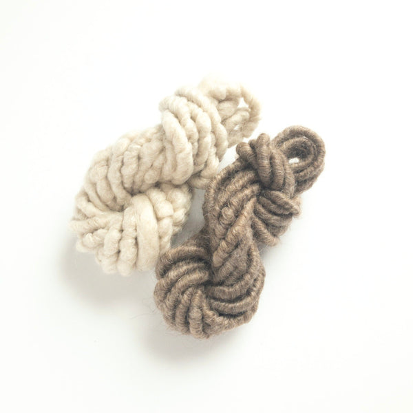 Hot cocoa fiber pack consisting of two mini skeins of white and brown corespun mohair yarn