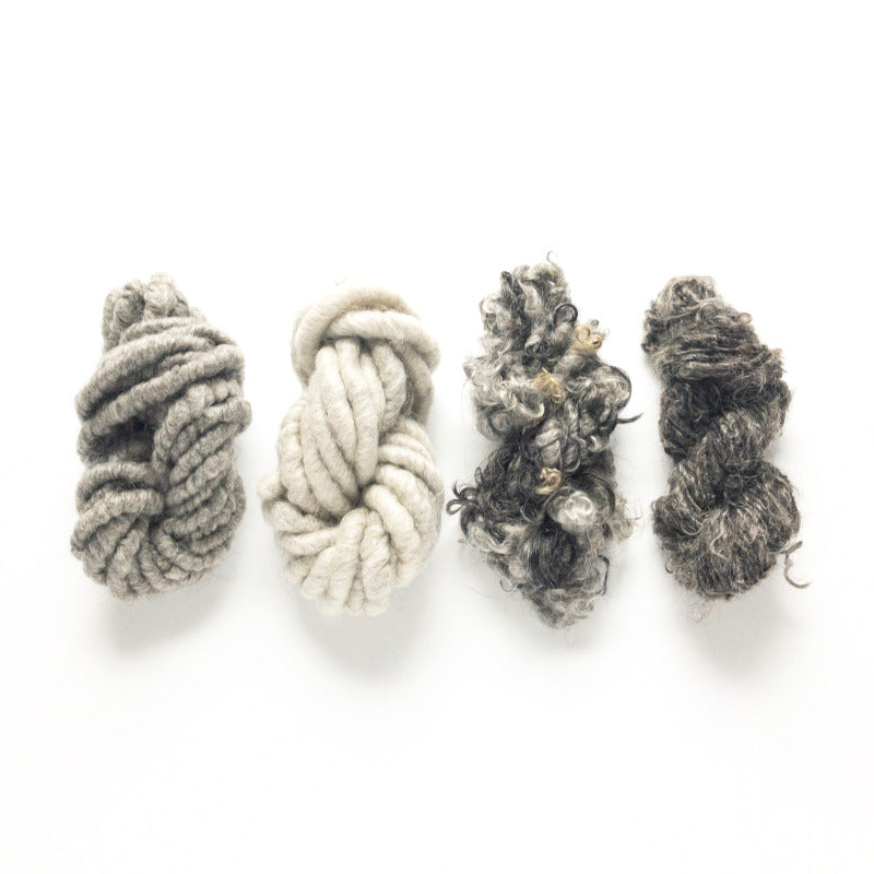 Shades of gray and different textures of mohair corespun and handspun and lockspun rustic yarn