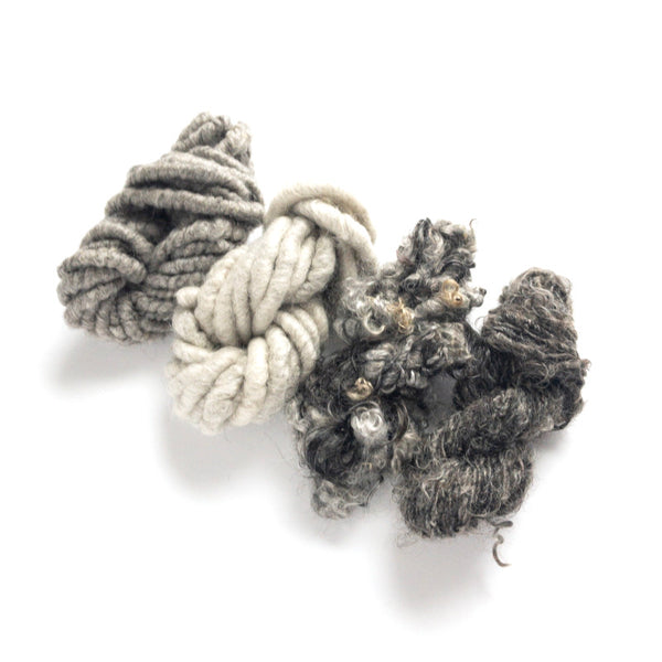 Four mini-skeins of shades of gray mohair corespun and handspun and lockspun rustic yarn
