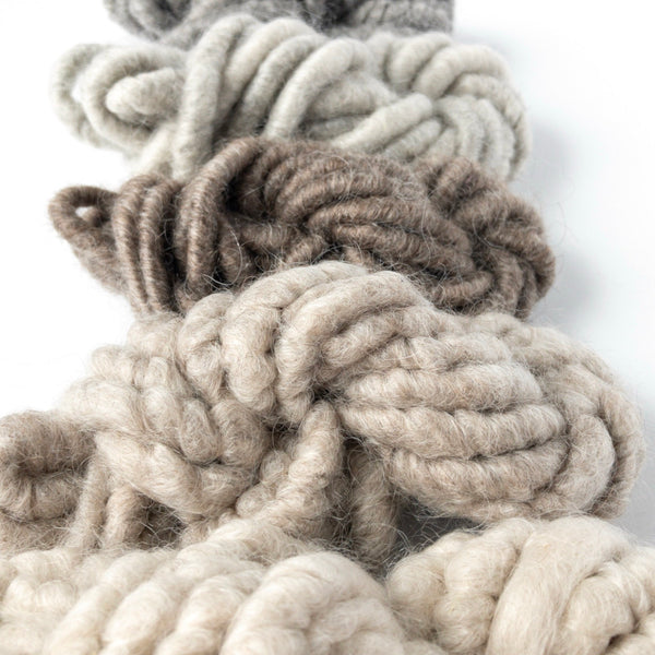 Five shades of white, khaki, brown, gray, and charcoal black mohair corespun yarn collection