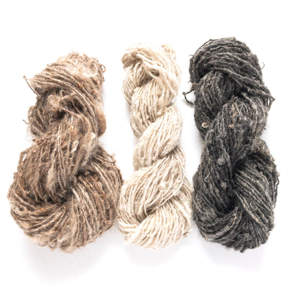 100% mohair handspun rustic yarn in brown, white, and charcoal