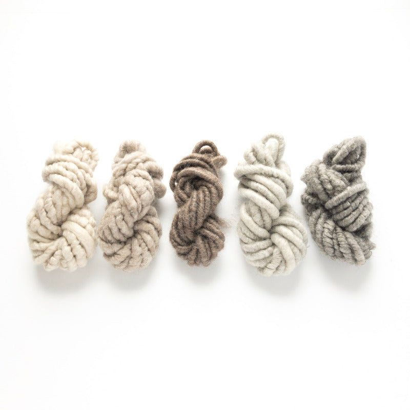 Five shades of white and brown and gray and black mohair corespun yarn collection