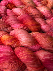 Pink Coral on 80% Superwash Merino/20% Nylon 2-Ply Twist Sock