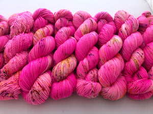 Lawn Flamingo on 90% Superwash Merino/10% Nylon SLUB sock yarn
