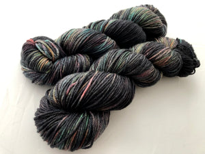 *OOAK Oil Slick WITH RED INSTEAD OF PINK on 70 Superwash Merino/30 Silk DK