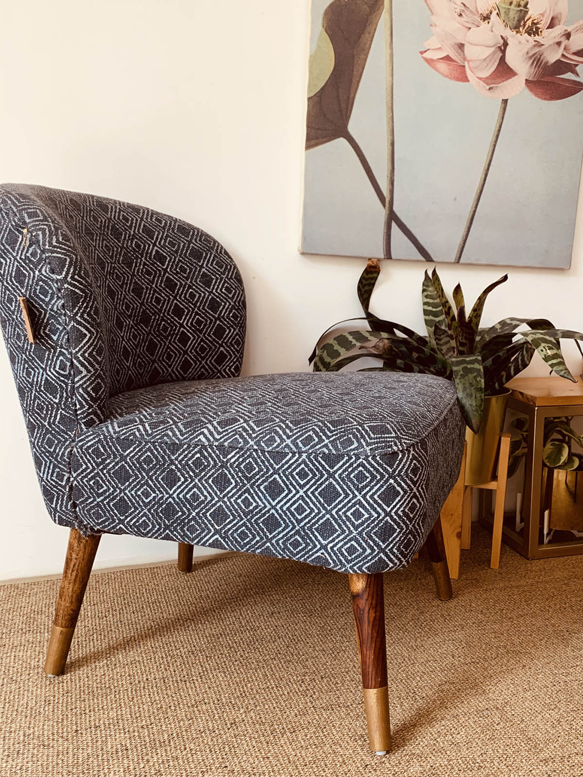 Lounge chair with block printed upholstery brass trimming at leg