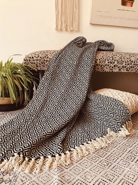 Diamond motif throw with tassels