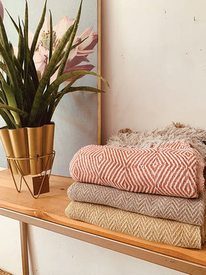 Diamond pattern throw in orange with tassels