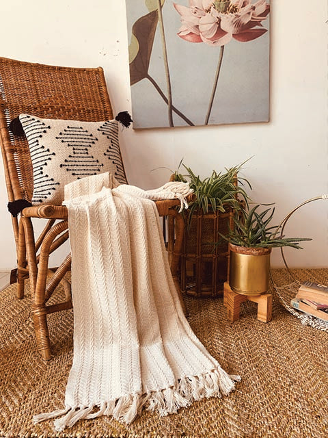 Textured ecru motif throw with tasseles