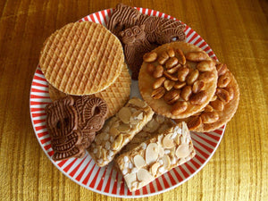 Dutch biscuits on a plate - speculaas - jan hagel - pindakoeken - stroopwafels  - big bite dutch treats
