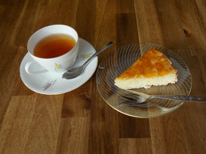 Slice of coconit tart on plate with tea - kokostaartje - Big Bite Dutch Treats