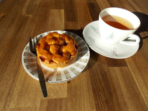 Apple pie on plate and cup of tea - Appeltaartje - Big bite Dutch Treats