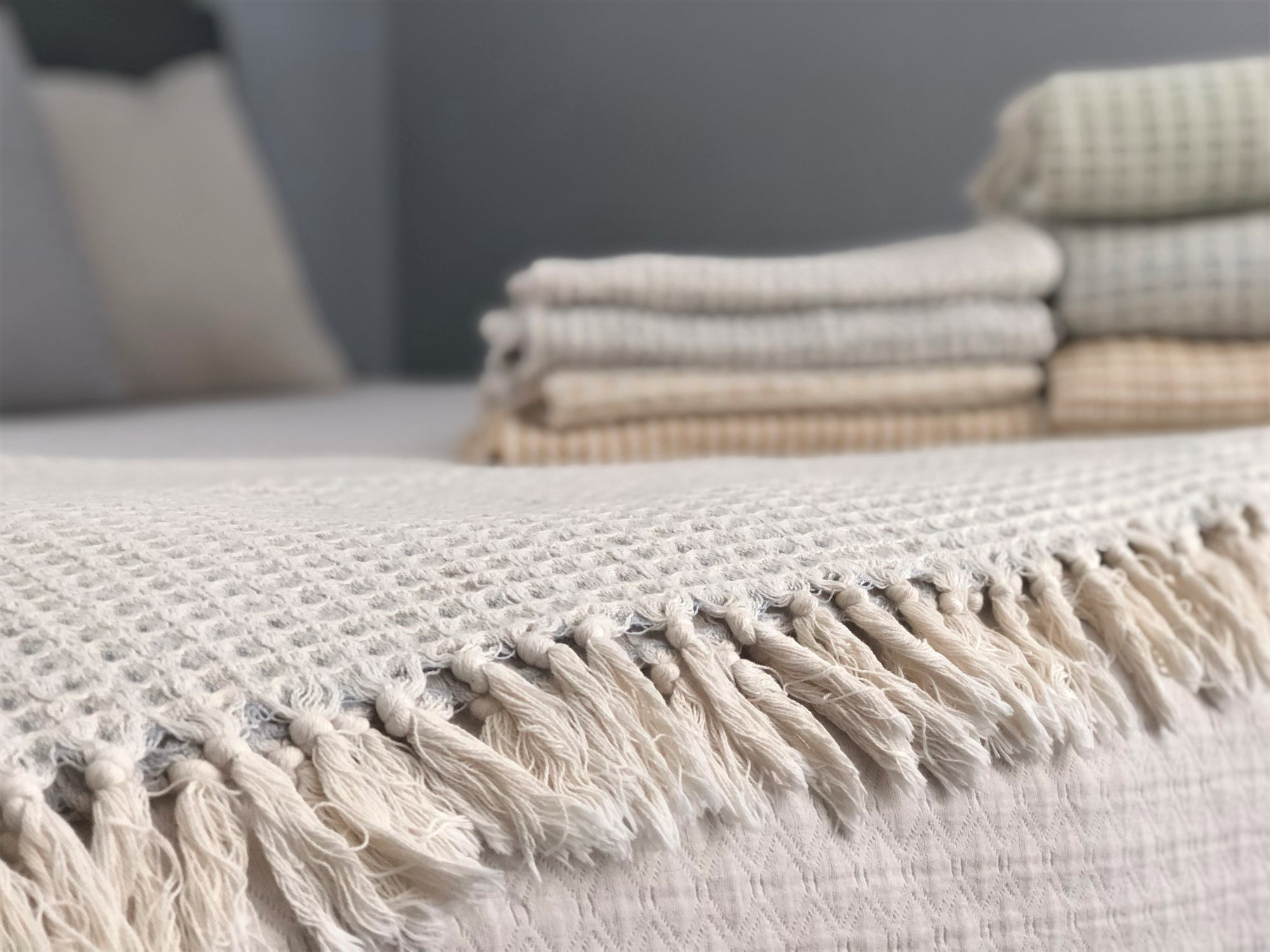 'airloom' throws in large and mini with handloomed organic turkish cotton in a cozy weighted waffle gauze-like pattern