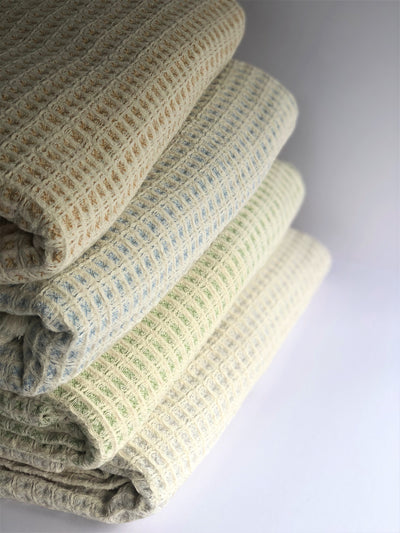 "the ""airloom"" throw line up: amber, sky, grass, and frost"