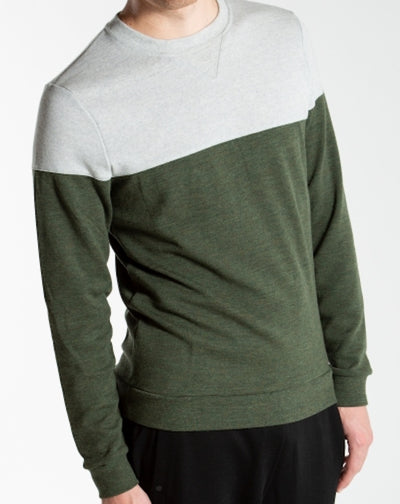 Man wearing a blocked green sweater by We Norwegians