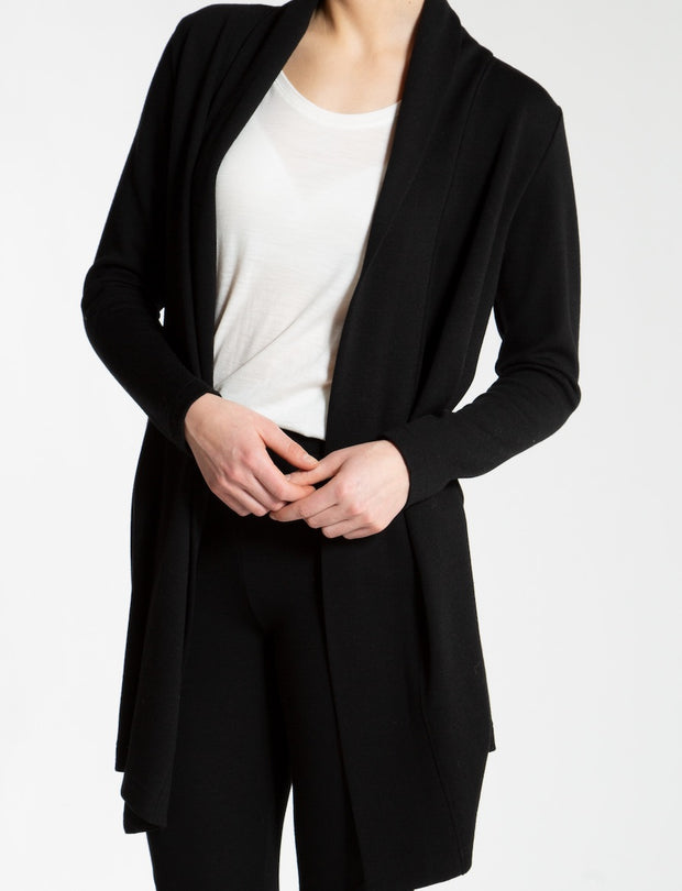 woman wearing a black cardigan by We Norwegians