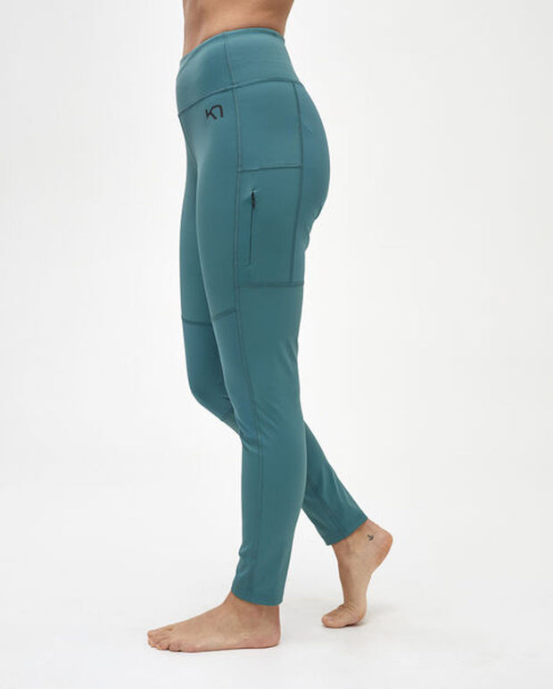 Woman wearing ivy green leggings by Kari Traa