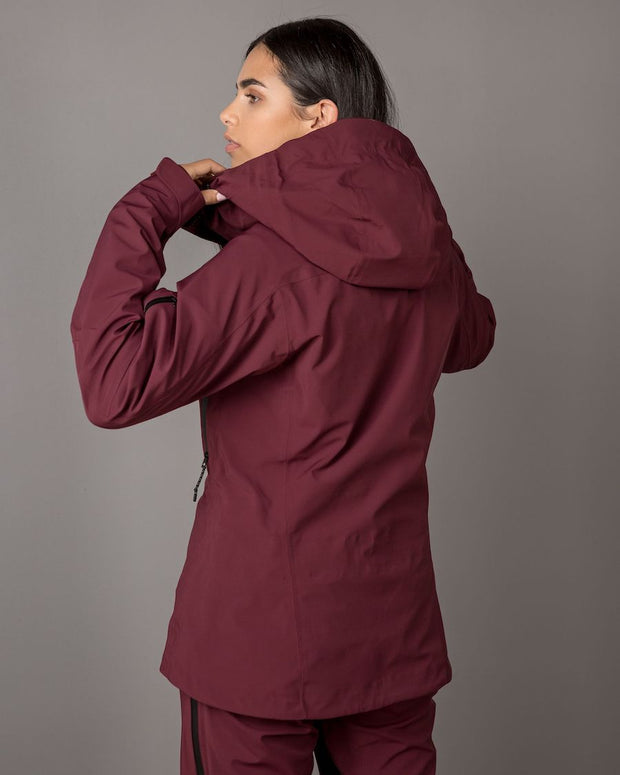 Woman in a maroon ski jacket by 8848