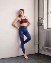 model resting in lux boho leggings by moonchild yoga wear for aktiv scandinavian athleisure