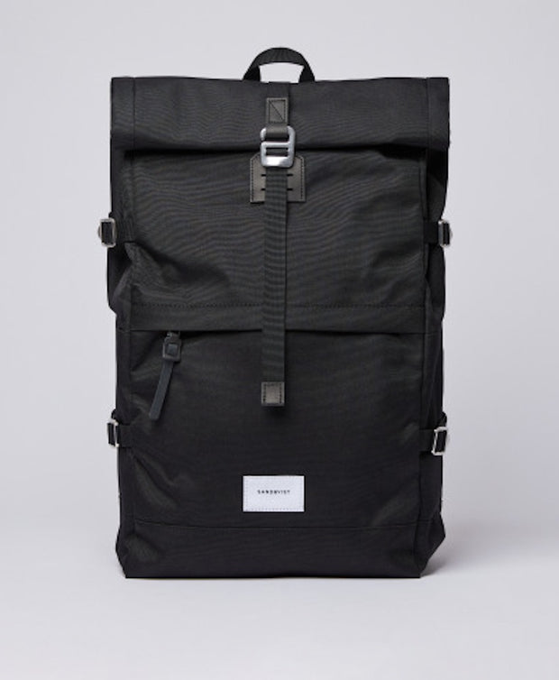 Functional backpack with a rolltop in black.