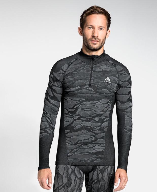 Man wearing a patterned black half zip base layer by Odlo