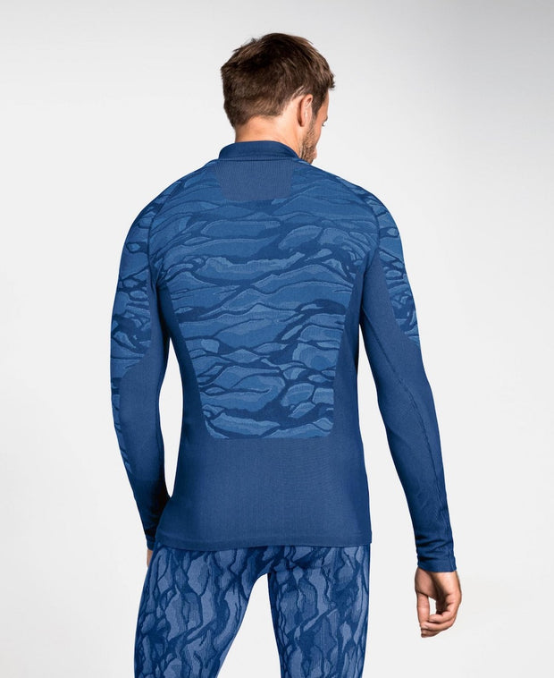 Man wearing a patterned blue half zip base layer by Odlo back view