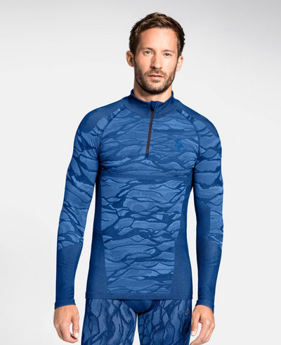 Man wearing a patterned blue half zip base layer by Odlo