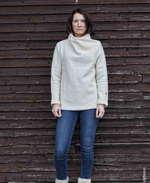Woman wearing jeans and a Cream elevated neck sweater for women by Ivanhoe of Sweden