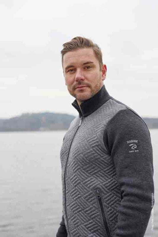 Man wearing a two toned grey and black zipped sweater from Ivanhoe of Sweden