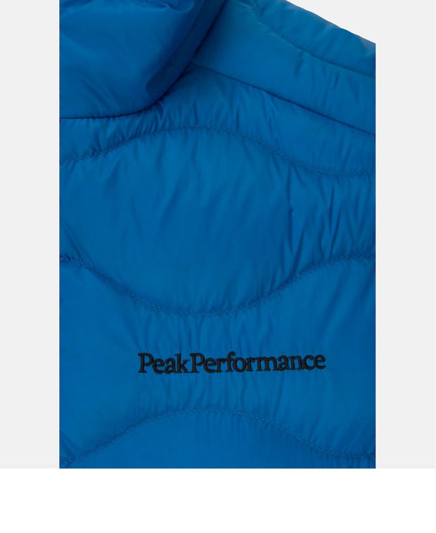 Close up of Light Blue vest for Men with Peak Performance written in black on upper left chest
