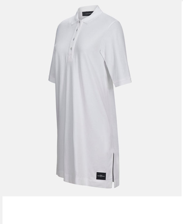 3/4 front view of White Polo Shirt Dress with black Peak Performance logo on bottom hem