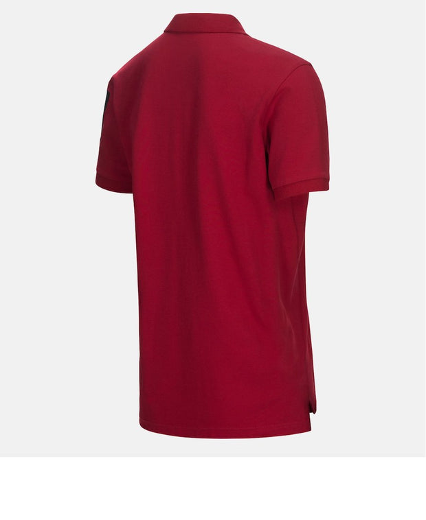 3/4 back of intense red polo shirt by Peak Performance for Aktiv
