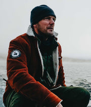 Stoic man in a boat wearing corduroy jacket with Wool inner liner by Amundsen Sports