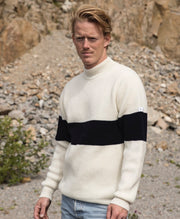 Blonde man with a white striped sweater