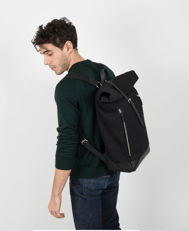 Marius Black backpack with black leather trim and two exterior zippers on Male Model
