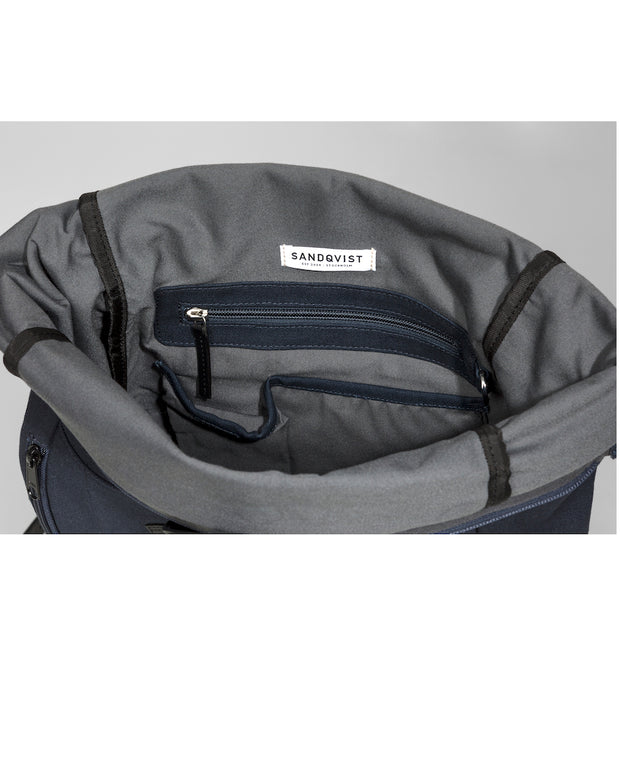 Marius Navy backpack with black leather trim and two exterior zippers interior view