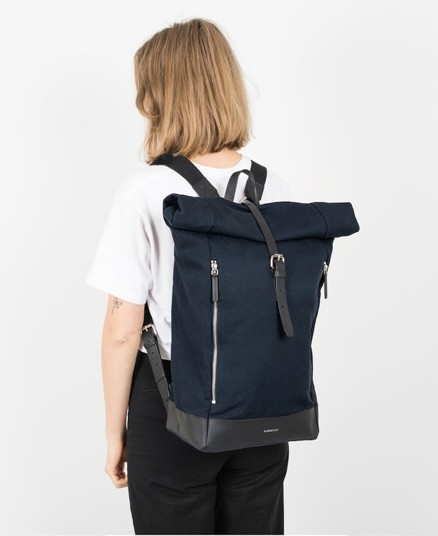 Marius Black backpack with black leather trim and two exterior zippers on Female Model