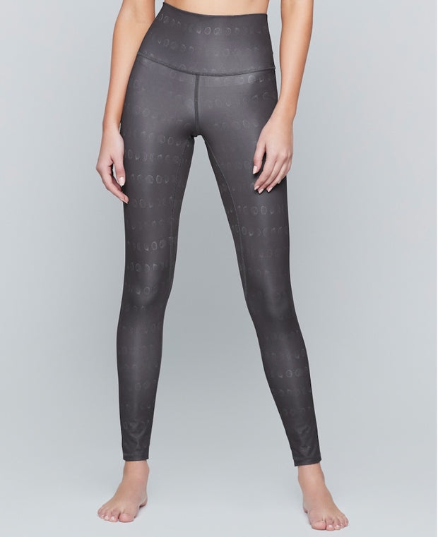 Silver yoga leggings with moons on them by Moonchild Yoga Wear
