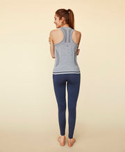 model posing in moonchild logo tank top for aktiv scandinavian yoga wear