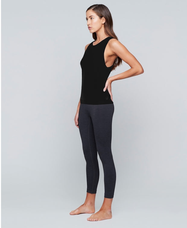 Woman wearing black tank top by Moonchild Yoga Wear